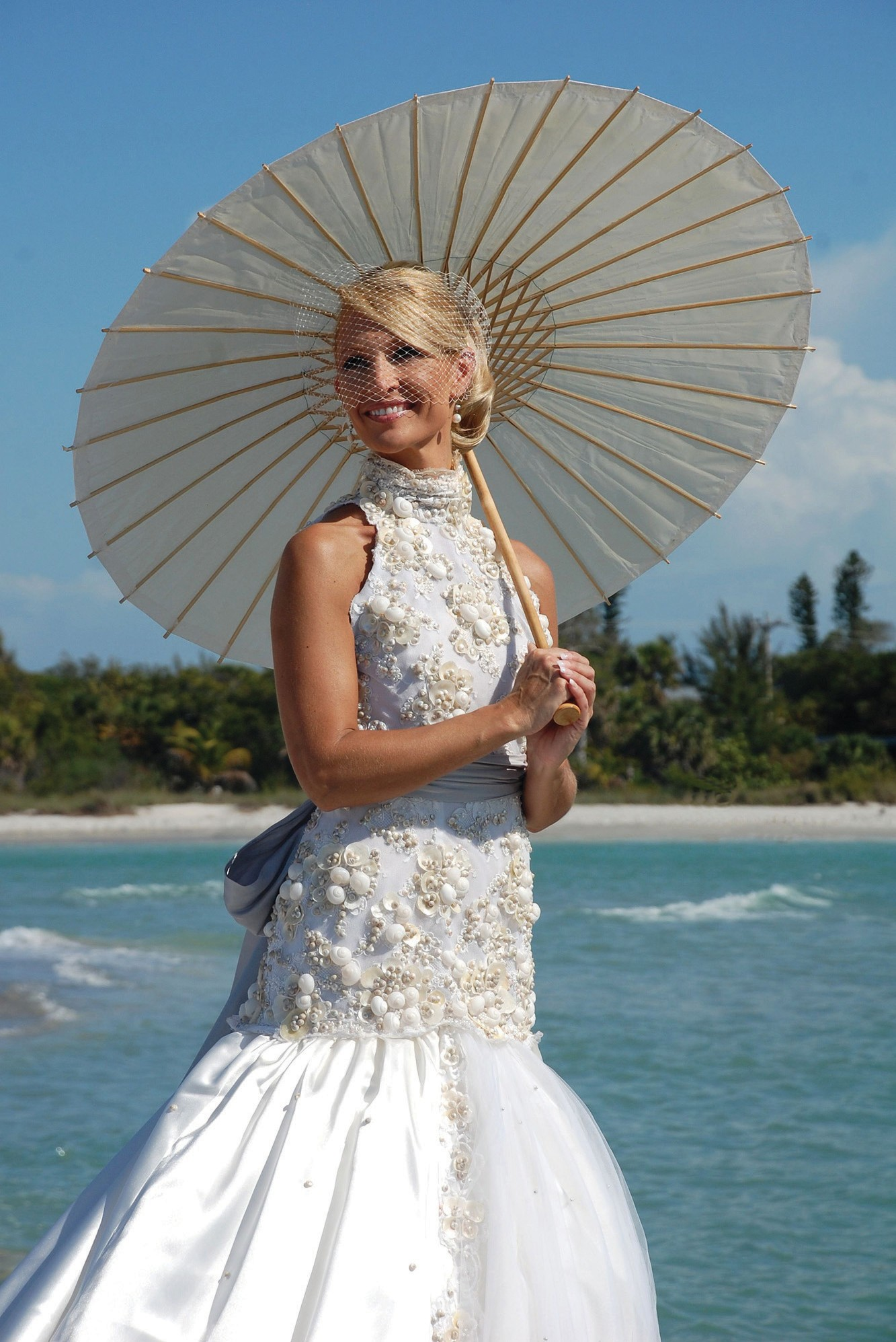 Shell-covered wedding dress on display | Fort Myers Florida Weekly