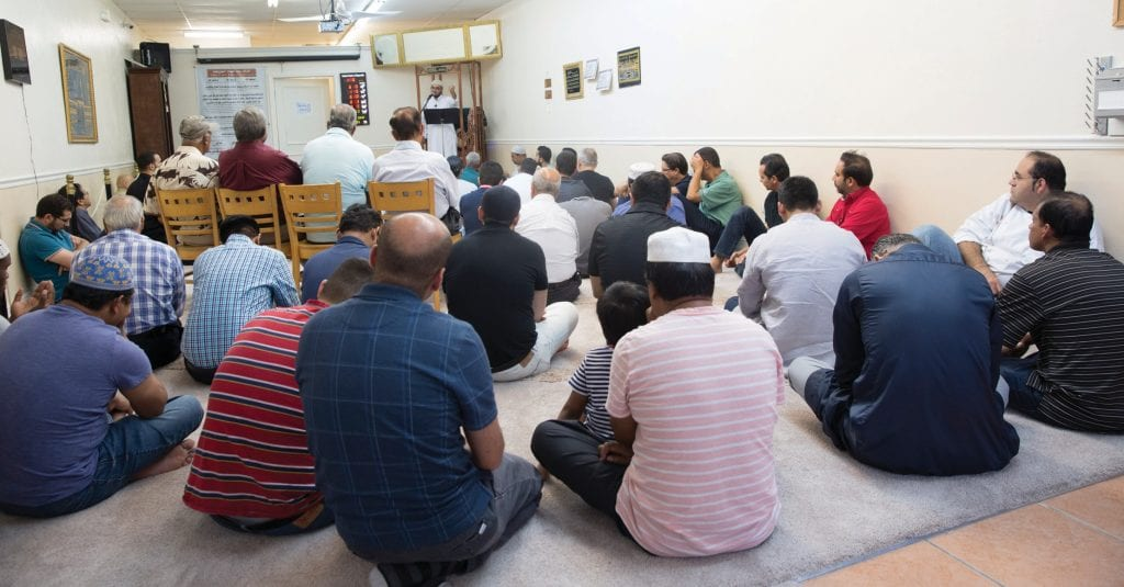 Members of the Islamic Center of Naples attend Friday afternoon services. Imam Muhammad Nour, the center's religious leader, gave a spirited sermon. CHRIS KOVAS / FLORIDA WEEKLY
