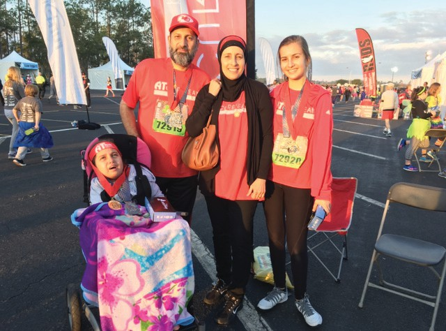 Port Charlotte resident Samera Musallet, center, and her family participate in the Disney Marathon at Disney World in Orlando. COURTESY PHOTO