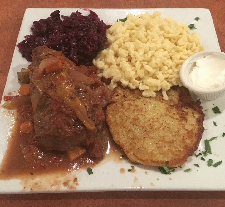 Beef rouladen with boiled red cabbage, spaetzle and a potato pancake.