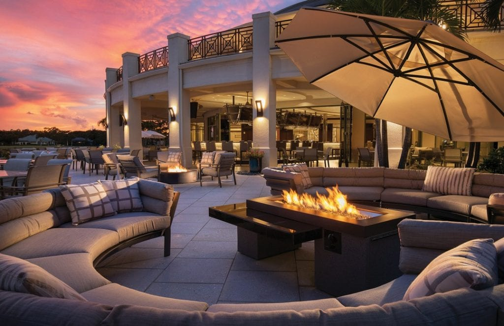 The new outdoor seating area at the Quail West clubhouse, overlooks one of the community's large lakes.