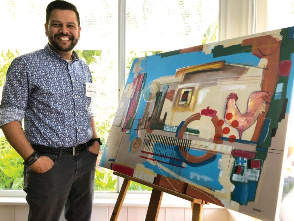 David Acevedo says the bright colors and roosters in his native Puerto Rico influence his art. STEPHANIE DAVIS / FLORIDA WEEKLY