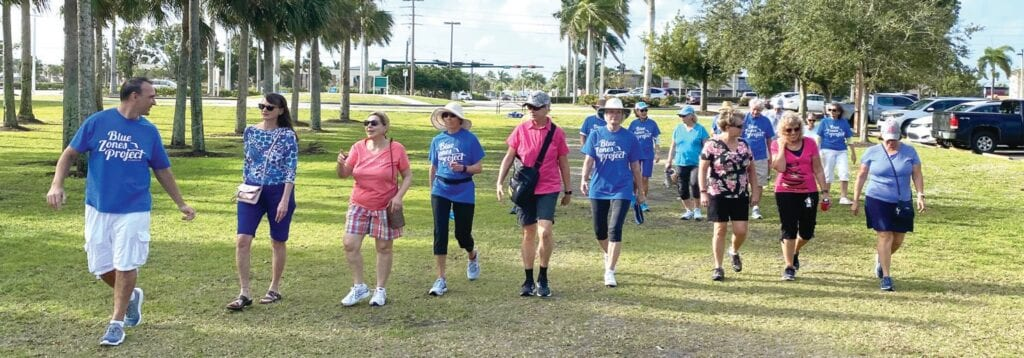 Blue Zones Project Southwest Florida engagement leader Rafael Campo leads a walking moai group at Eagle Lakes Community Park in Collier County. COURTESY OF BLUE ZONES PROJECT SOUTHWEST FLORIDA